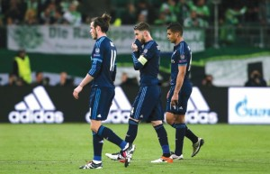 L-R) Real Madrid's Welsh forward Gareth Bale Real Madrid's defender Sergio Ramos and Real Madrid's Brazilian midfielder Casemiro react after the UEFA Champions League quarter-final, first-leg football match between VfL Wolfsburg and Real Madrid on April 6, 2016 in Wolfsburg, northern Germany.  Wolfsburg won the match 2-0. / AFP PHOTO / RONNY HARTMANN