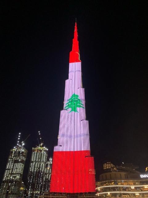 بالصور إضاءة برج خليفة في دبي بألوان العلم اللبناني